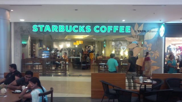"On the outside, just like any other Starbucks in any other mall.  Excepting the ""Tata"" sign in top right, which is pretty much the parent company of any venture in India."