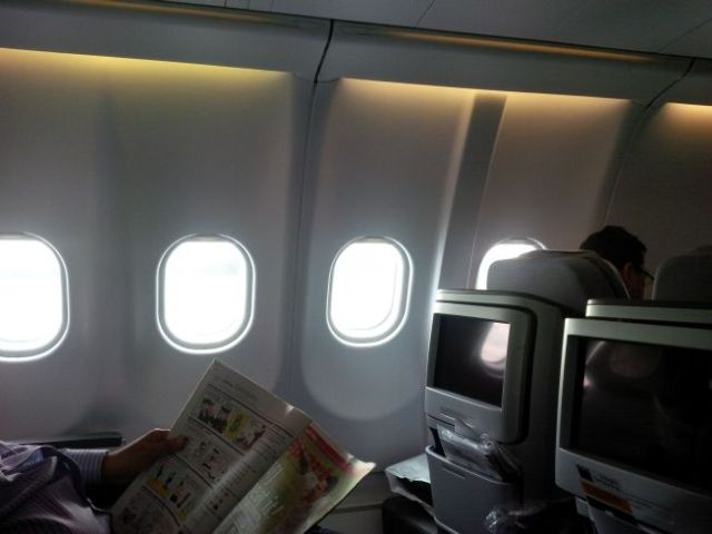 I do miss having windows. But I learned that middle Business Class seats mean nobody crawls over you when they need to get up, and you don't crawl over anybody.  Besides, what's there to see at 35000 feet but clouds.