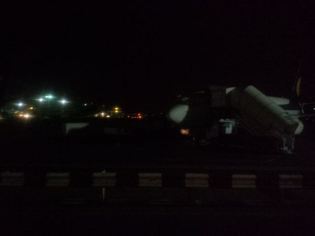 Apron boarding. Mumbai was very warm, too.  Hot air, tired me, and jet fuel exhaust. I really needed a shower.